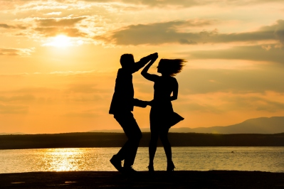 Couple dancing salsa at sunset